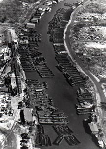Aerial view of Bayou St. John with Higgins  LCVPs, LCSs, and PT-Boats awaiting shipment.